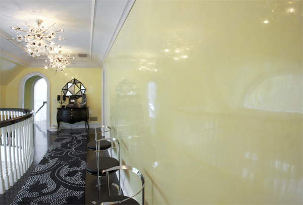 Venetian Plaster In A High Shine Yellow Warms A Mezzanine Hallway