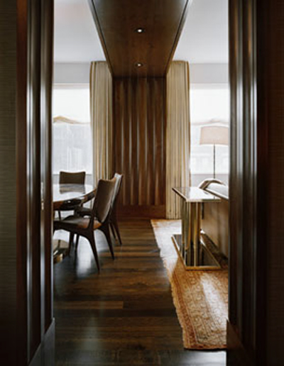 Fluted walnut paneling in an interior designed by Fox-Nahem