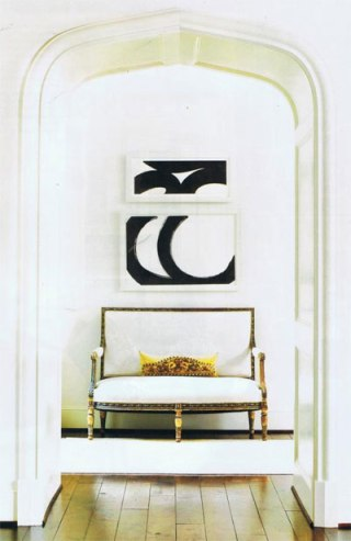 An arched hallway vignette is washed white.