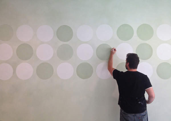 Sam Simon paints a polka dot wall mural