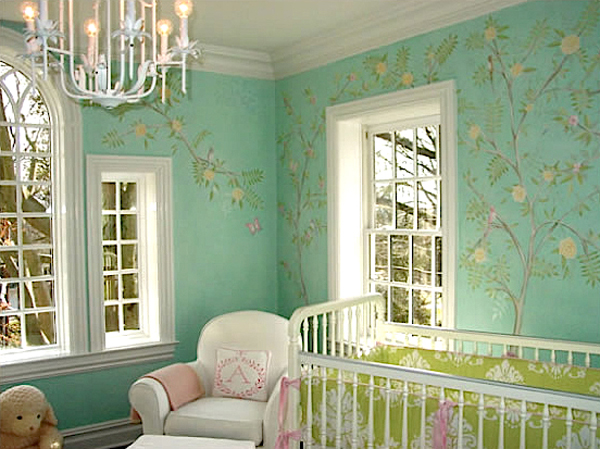 A green nursery sprouts floral tree patterned walls.