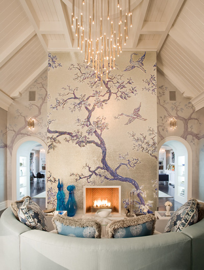 Custom tile mosaic with flanking wall murals in living room by Nicole Fuller Interiors