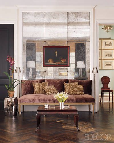 The man has glamour down! Antique mercury glass mirror panels set the stage for a sophisticated seating area in Interior Designer Todd Alexander Romano's NYC apartment. Photo via Elle Decor