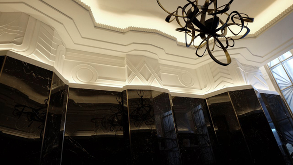 Deco flourishes - white custom plaster friezes by SuperStrata in the Walker Tower Lobby.