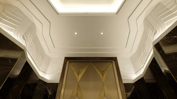 Custom plaster friezes by SuperStrata integrated into the Art Deco concept in the Walker Tower Lobby.