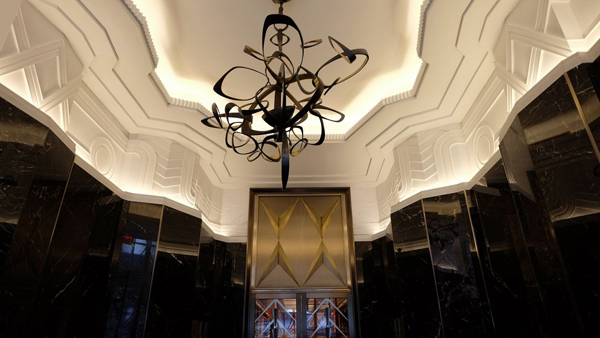 Custom, handmade plaster friezes by SuperStrata provide Deco adornment in the Walker Tower lobby.